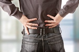 Man struggling with back pain